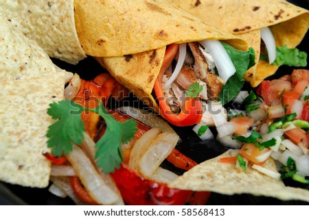 Spicy chicken wrap stuffed grilled meat, bell pepper, onions and cilantro with salsa and tortilla chips