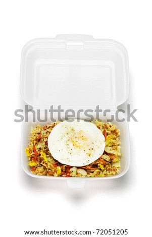 Spicy fried rice with egg in open Styrofoam box on white background - stock photo