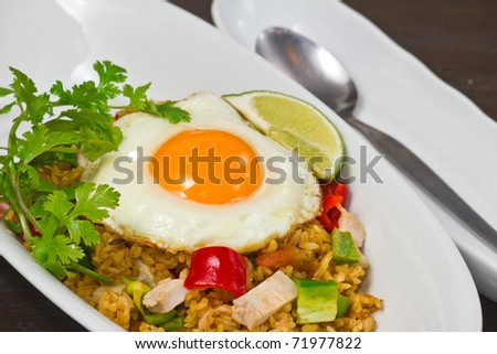 Spicy fried rice with sunny-side up egg - stock photo