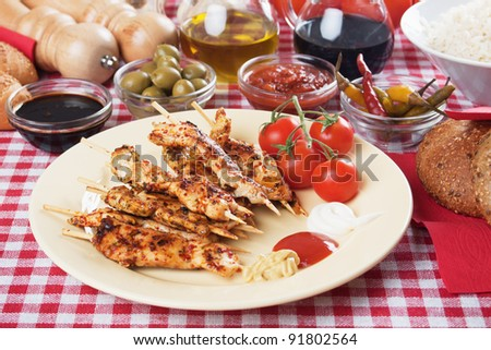 Spicy grilled chicken skewer with ketchup, mustard and mayonnaise