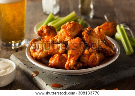 Spicy Homemade Buffalo Wings with Dip and Beer #308133770