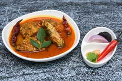 Spicy hot Kerala / Goa masala fish curry, ingredients. King/Barracuda fish in South India, coastal area of Sri Lanka, Malaysia, Thailand, Singapore. made by marinated fish with Indian spices. sea food