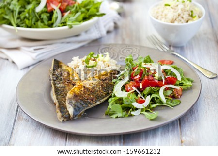 Spicy mackerel fillet with rice and salad