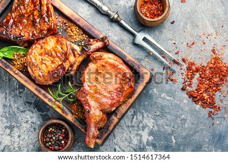 Spicy meat grilled spare ribs on wooden cutting board.Roasted ribs