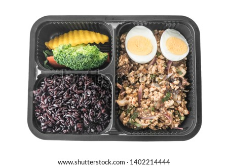Spicy minced chicken breast salad with boiled egg, steamed carrot, steamed broccoli, steamed pumpkin and rice berry. Isolated on white background with clipping path. #1402214444
