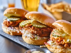 spicy nashville hot chicken sandwich with coleslaw and pickles