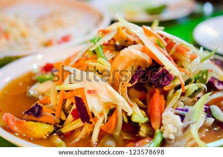 spicy papaya salad , mixed seafood on dish