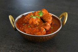 Spicy red chicken curry. Goan style chicken vindaloo. Butter chicken Murgh Makhani curry roast hot and spicy gravy dish Dhaba Punjab, India. North Indian non-vegetarian cuisine Garam Masala. tikka