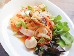 Spicy salad mix seafood plate with Squid Mussel Shrimp and fresh vegetable served on dining table