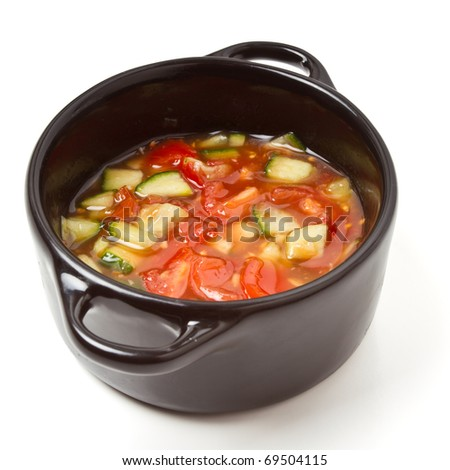 Spicy Salsa in small black cast Iron serving pot.