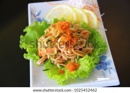 Spicy seafood salad and fresh vegetables salad on the white dish, Ready to served. #1025452462