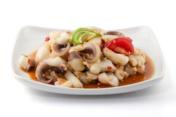 Spicy seafood salad with Squid isolated on white background, Somtum Talay, Thai food.