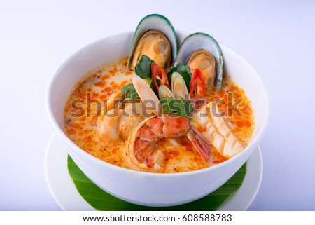 Spicy Seafood Soup on white dish , thai cuisine , white background
