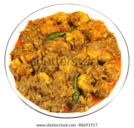 Spicy shrimp curry on a white bowl