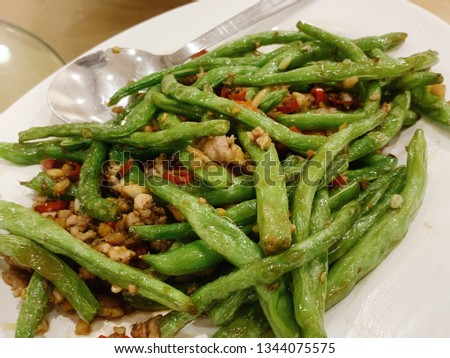 Spicy stir-fried green beans with minced pork on white plate.Famous Chinese cuisine. #1344075575