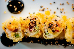 Spicy tuna sushi roll. Japanese ahi tuna sushi roll. Classic Japanese roll made with seafood, seaweed, sushi rich and cucumber. Traditional Japanese izakaya restaurant cuisine.