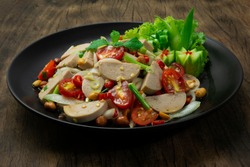Spicy Vietnamese Pork Sausage Salad with Vegetables GoodTasty Appetizer Healthyfood or diet The Most Popular Thai &Vietnamese Food Fusion Style decorate Vegetables and cucumber sideview