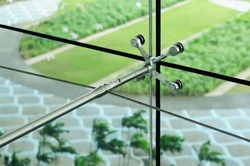 Spider fittings for frameless glass facades and walls.