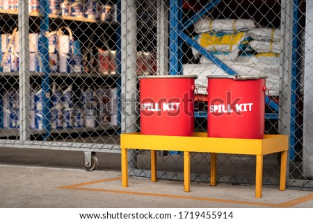 Spill kit containment boxes are prepared and placed in front of the chemical storage room. Using in emergency case of chemical spill or leak on ground. Stock foto ©