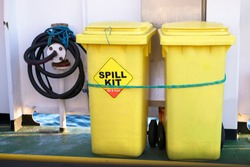 Spill kit yellow wheelie bin for health and safety of chemical, oil, diesel or petrol pollution leak