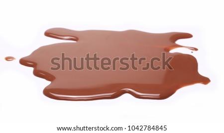 Spilled chocolate milk puddle isolated on white background