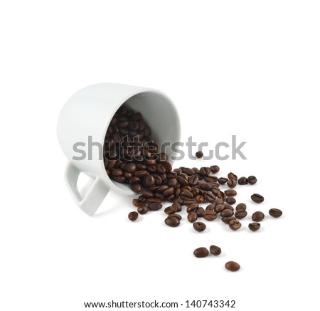 Spilled coffee beans from the white ceramic cup isolated over white background