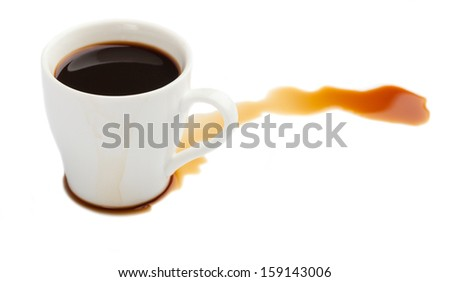 spilled coffee from a cup isolated on white