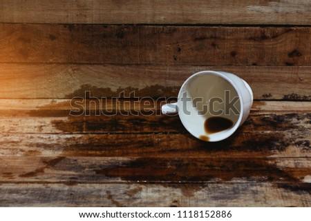 Spilled coffee on wooden deak