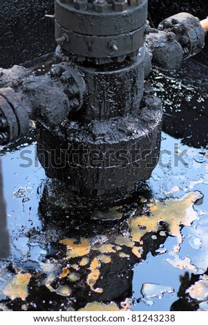 Spilled crude oil around oil field. Oil and Gas Industry. Environmental pollution.
