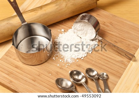 Spilled Scoop of Cooking Flour with Miscellaneous Baking Tools