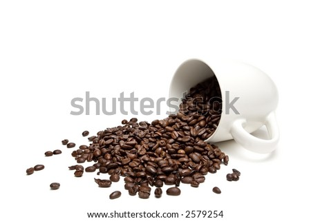 spilt coffee beans - spill the beans - closeup of whole beans with limited depth of field, isolated on white
