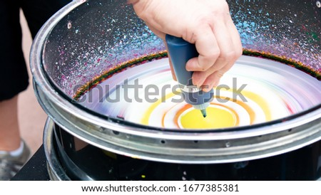 Spin art colourful painting in a rotating drum