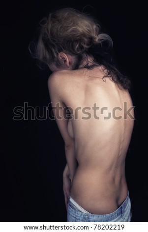 spin of a beautiful young woman on a black background
