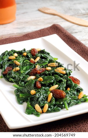 Spinach Catalan style, with raisins and pine nuts, a traditi..