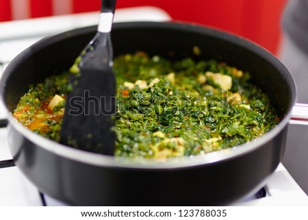 Spinach cooking in a pan on the gas stove