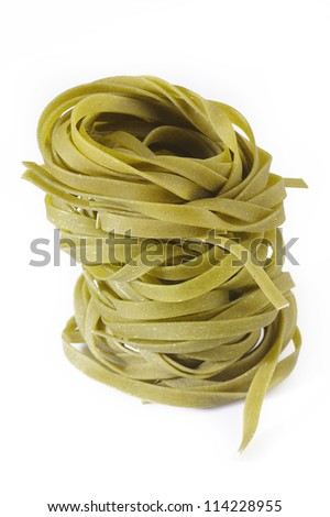spinach fettuccine pasta on white background