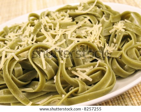 Spinach fettuccine with extra virgin olive oil and freshly grated parmesan cheese.