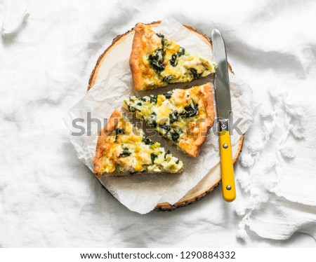 Photo of  Spinach, leek, chicken, cheese pie on light background, top view