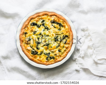 Photo of  Spinach, leek, potato, cheese pie on light background, top view. Delicious homemade food