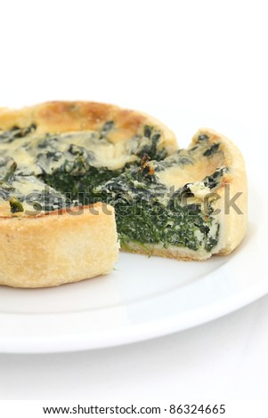 spinach quiche pie isolated on white background
