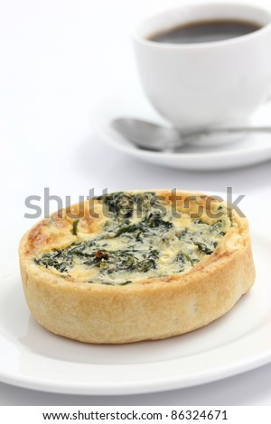 spinach quiche pie with coffee isolated on white background
