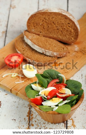 Spinach Salad with Egg and Bread