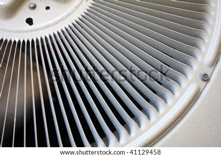 Spinning air conditioner fan and vent