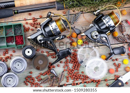 Spinning and reels, accessories for fishing on the table in composition #1509280355