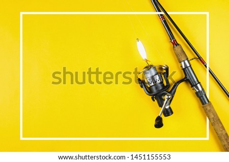 Spinning and tackle on yellow background #1451155553