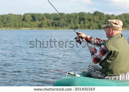 Spinning fisherman on a boat fishing #301400369