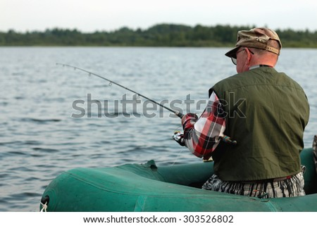 Spinning fisherman on a boat fishing #303526802