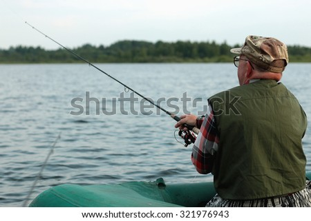 Spinning fisherman on a boat fishing #321976943