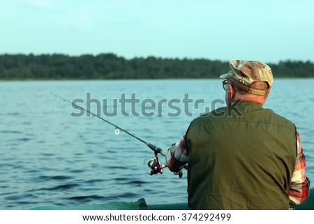 Spinning fisherman on a boat fishing #374292499