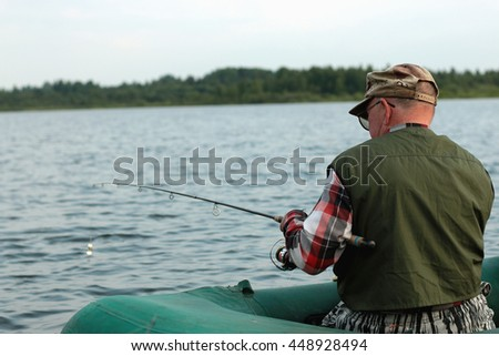 Spinning fisherman on a boat fishing #448928494